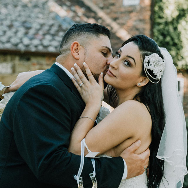 Melbourne wedding photography portfolio showing just married couple having bridal portrait at Fitzroy Gardens 2018