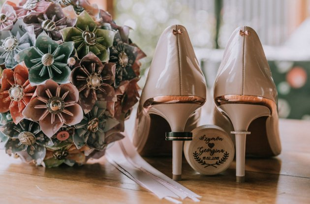 Wedding detail shot of bridal shoes and bouquet at Immerse Yarra Valley wedding reception by Black Avenue Productions