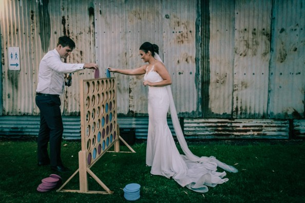 Candid vs Traditional wedding photography showing couple playing game in Mornington Peninsula