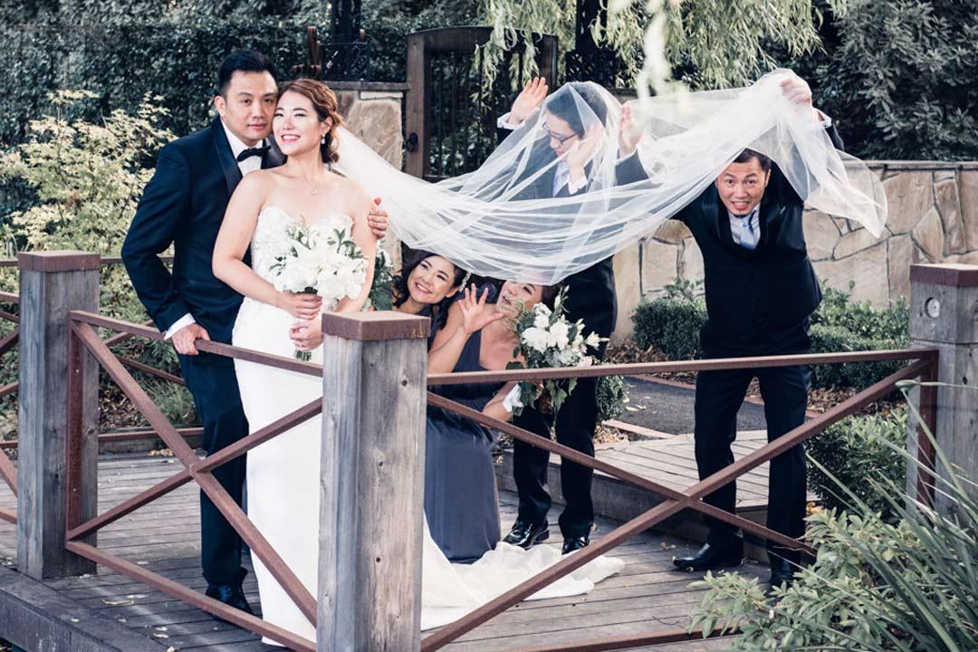 bridal party having fun with Melbourne bride and groom at Ballara Receptions