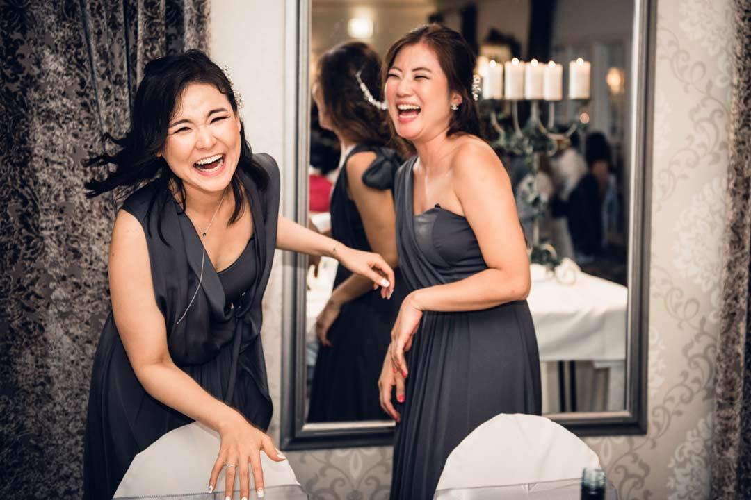 funny bridesmaids laughing so hard at Ballara Receptions wedding venue