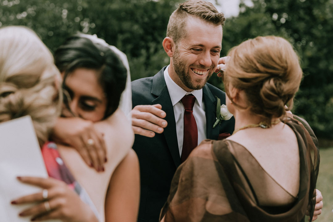 emotional moment of bride groom hugging their mothers after rustic farm wedding Melbourne captured by best wedding photographers Black Avenue Productions