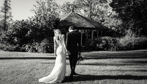 black and white wedding photo at Royal Botanical Gardens a boho bride walking to ceremony with groom