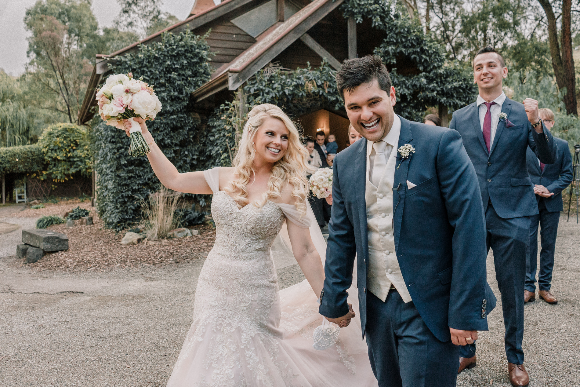 Melbourne couple cheering after their Inglewood Estate wedding candid moment featured in Easy Weddings blog 7 things your wedding photographer wish you knew