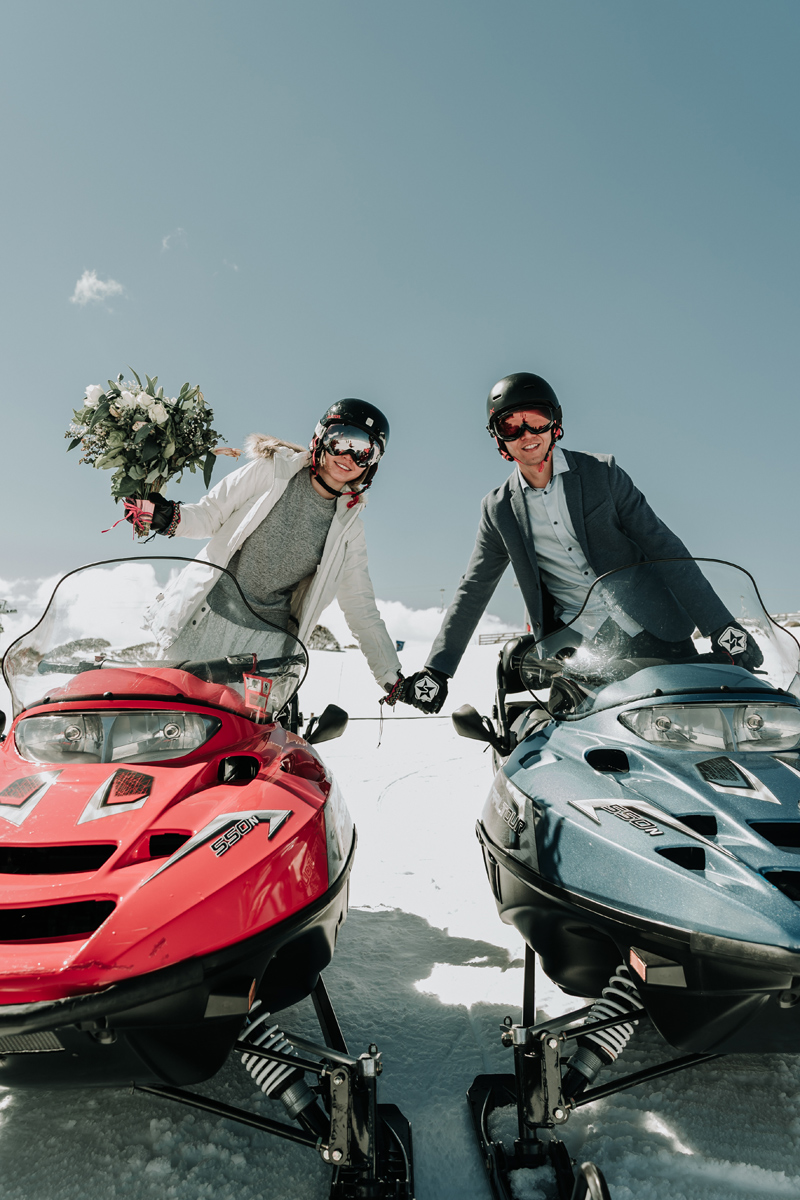 romantic wedding photo on snow mobil in Falls Creek