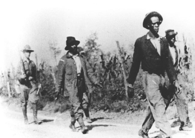 African-American men taken prisoner during the Elaine Massacre by U.S. Army troops sent from Camp Pike; 1919. Courtesy of the Arkansas State Archives
