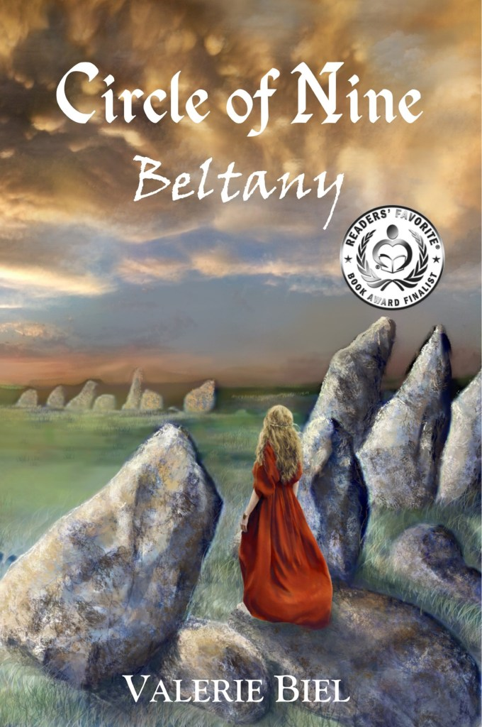 Book Cover. Circle of Nine: Beltany by Valerie Biel. Blonde girl in a red dress standing on rocks.