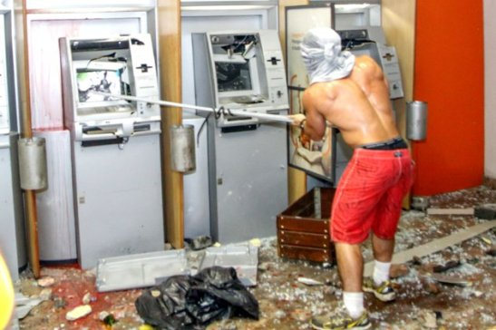 Protester smashes money machines in downtown Rio de Janeiro