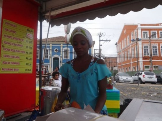 """A young black street vendor selling """"acarajé"""", a traditional type of fritter, in Salvador, Bahia in Brazil's Northeast. Credit: Fabiana Frayssinet/IPS"""