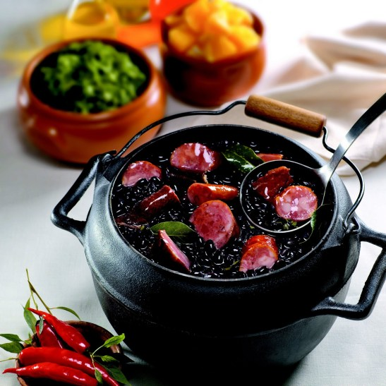 "The Brazilian national cuisine known as ""feijoada"" has origins in the slavery era"