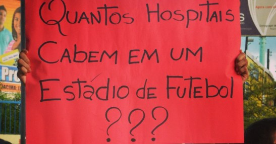 """Sing from June 2013 protests: """"How many hospitals can fit inside of a soccer stadium?"""""""