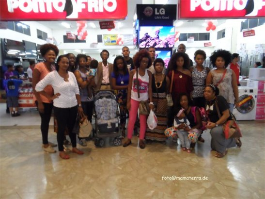 After confronting store officials, Thayná and her support group pose for a photo