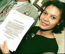 Sandra Regina shows birth certificate showing Pelé as her father