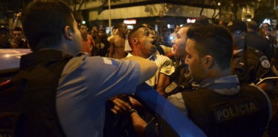 Resident of Pavão-Pavãozinho reacts as he is detained by police during protest