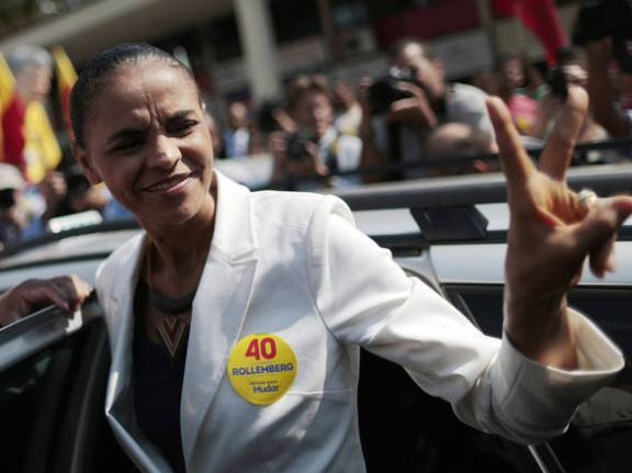 Presidential candidate Marina Silva (PSB) waves to supporters during a campaign stop in Brasília