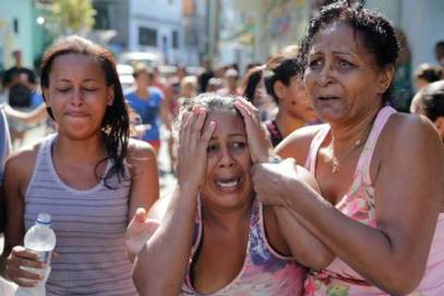 Mother of 12-year old Gilson Costa reacts to the murder of her son