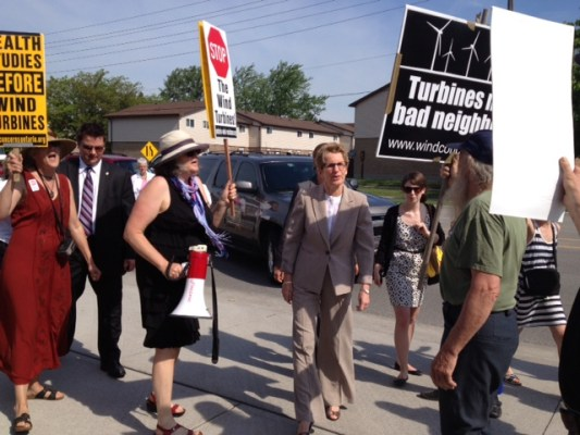 Ontario Premier Kathleen Wynne is greeted by wind turbine protesters at an event in Sarnia. May 31, 2013 BlackburnNews.com (Photo by Chelsea Vella)