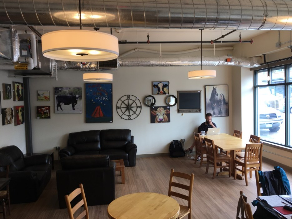 Morrisville Black Cap Coffee seating area with couches and tables.