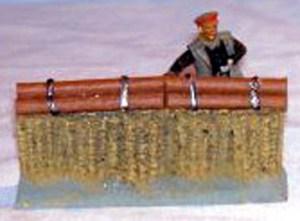 Gabion row with log facine approx 90mm long