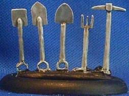 tool sprue spade, 2 shovels, fork, pick axe.