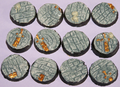 12x 25mm Broken Sword bases.