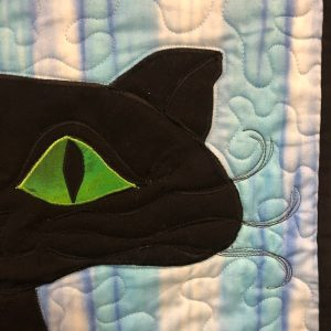 black cat green eye quilt