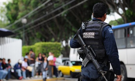 Mexican federal police patrol the streets of Guadalajara. Widespread dissatisfaction with law enforcement and the justice system has fuelled public sympathy for vigilantes. (Photograph: Dennis Grombkowski/Getty Images)