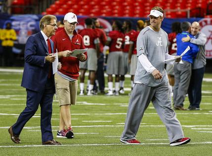 FILE - In this Dec. 2, 2016, file photo, Alabama head coach Nick Saban, left, talks with Alabama offensive coordinator Lane Kiffin, right, during practice for the Southeastern Conference Championship NCAA college football game, in Atlanta. A person with direct knowledge of the situation tells The Associated Press that Alabama offensive coordinator Lane Kiffin has agreed in principle to become the next coach at Florida Atlantic. The person, who spoke to the AP on condition of anonymity because neither side had revealed anything publicly, said the school was preparing an announcement likely to come later Monday, Dec. 12, 2016.  (AP Photo/Butch Dill, File)