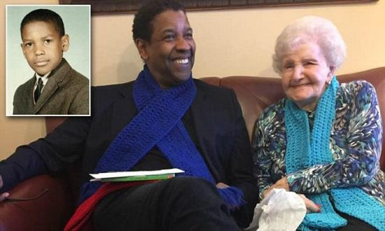 """A photo posted on Imgur Thursday (pictured) shows the woman next to Hollywood legend Denzel Washington. The librarian is beaming and both have handmade scarves around their necks. The person who published the photo said in the caption it showed her grandmother, a 99-year-old former librarian from Mount Vernon, next to Washington, whom she had always remembered fondly. Several people had tried to contact Washington to arrange a meetup, to no avail, the poster wrote. But the librarian finally got to talk to him on the phone on her 99th birthday, and the two finally made plans for a reunion. 'She ALWAYS tells the story of how she gave Denzel Washington his first library card and how she remembers him for his unique name """"and he was the cutest thing,"""" ' the poster wrote."""