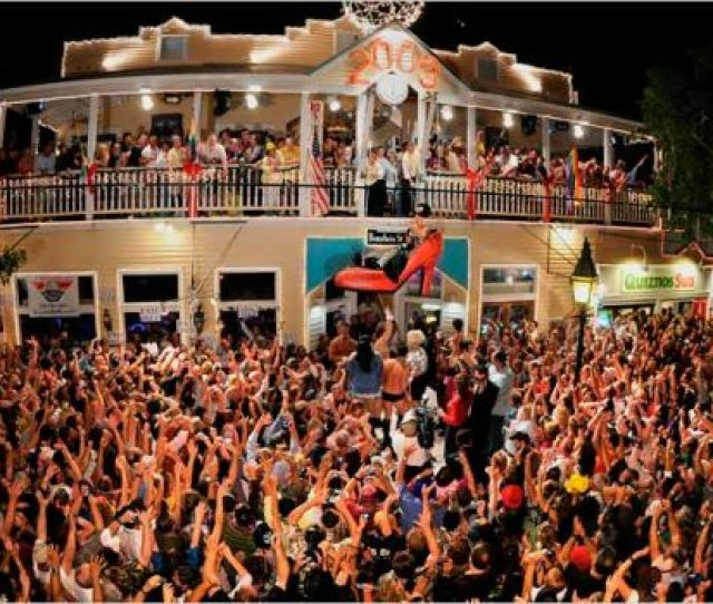 Partyers Outside The Bourbon Street Pub Complex In Key West Fla Celebrated The Lowering