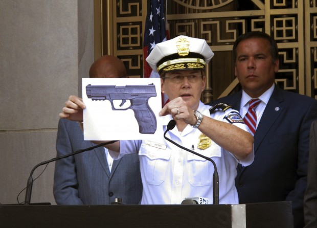 Columbus Police Chief Kim Jacobs holds up a photo of the type of BB gun that police say 13-year-old Tyre King pulled from his waistband just before he was fatally shot on Sept. 14, 2016. (Andrew Welsh-Huggins/Associated Press)
