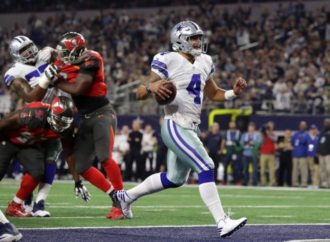 Cowboys quarterback Dak Prescott rushed for a touchdown in the first half against the Buccaneers. Credit Ronald Martinez/Getty Images