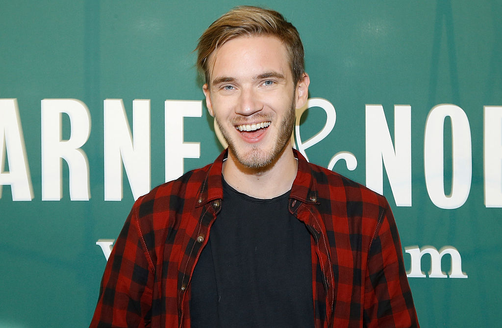 """PewDiePie signs copies of his new book """"This Book Loves You"""" at Barnes & Noble Union Square on October 29, 2015 in New York City."""