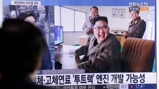North Korean leader Kim Jong-un cheers the rocket test at the Sohae launch site. (Ahn Young-joon/Associated Press)