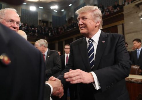 U.S. President Donald Trump shakes hands after delivering  his first address to a joint session of Congress from the floor of the House of Representatives iin Washington, U.S., February 28, 2017.  REUTERS/Jim Lo Scalzo/Pool