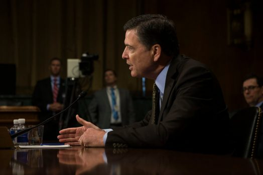 """James B. Comey, the F.B.I. director, testifying on Capitol Hill on Wednesday. He calls Section 702 of the FISA Amendments Act an """"essential tool."""" (Credit: Gabriella Demczuk for The New York Times)"""