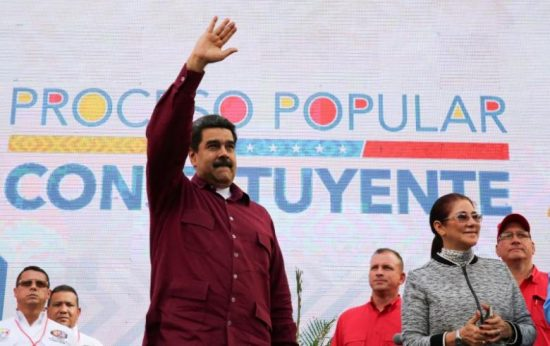 Venezuela's President Nicolas Maduro greets supporters next to his wife Cilia Flores (R), during a meeting at Miraflores Palace in Caracas, Venezuela May 19, 2017. Miraflores Palace/Handout via REUTERS