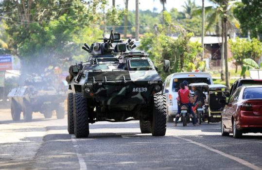 An armoured personnel carrier belonging to government troops drives along a main highway of Pantar town, Lanao Del Norte, as it travels to reinforce Marawi city, southern Philippines May 24, 2017. REUTERS/Romeo Ranoco