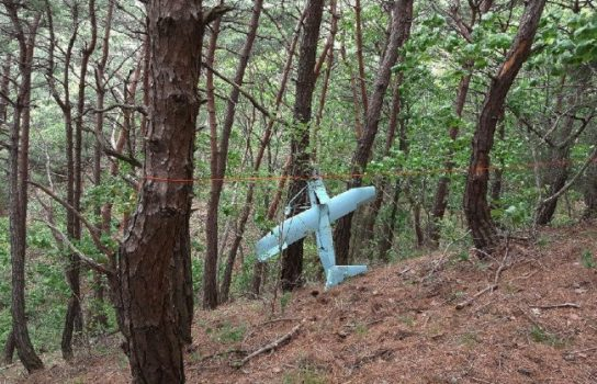 In this Friday, June 9, 2017 photo provided by South Korean Defense Ministry on Tuesday, June 13, 2017, a suspected North Korean drone is seen in a mountain in Inje, South Korea. ( /Associated Press)