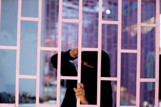 A woman looks from behind bars of a hospital ward allocated for cholera-infected patients in Sanaa, Yemen May 7, 2017. (REUTERS/Khaled Abdullah)