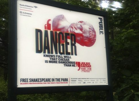 "In this June 7, 2017 photo, ""Danger knows full well that Caesar is more dangerous than he,"" reads a sign promoting The Public Theater's production of Julius Caesar in New York's Central Park. (Verena Dobnik/Associated Press)"