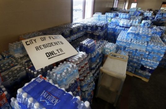 Hundreds of cases of bottled water are stored at a church in Flint, Mich., in 2016. (Carlos Osorio/AP)