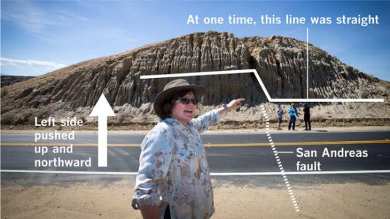 Seismologist Lucy Jones stands on top of the San Andreas fault, which has pushed up the left side of the hill northward and higher than the side to the right from past earthquakes. (Photo by Allen J. Schaben / Annotation by Raoul Ranoa / Los Angeles Times)