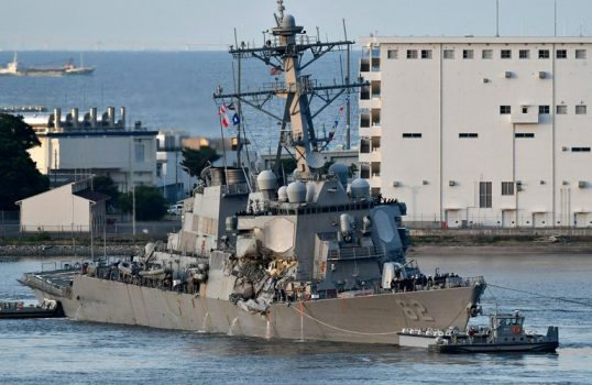 The USS Fitzgerald returned to Yokosuka Naval Base with the help of tugboats after its collision with the container ship ACX Crystal off the coast of Yokosuka, Japan. (Credit: Franck Robichon/European Pressphoto Agency)