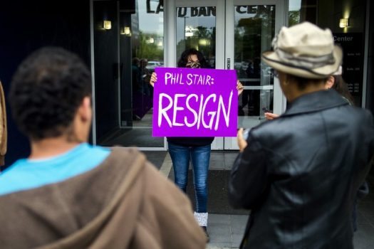 Protesters called for the resignation of Philip Stair, a sales manager at the Genesee County Land Bank, in Flint, Mich., on Monday. Mr. Stair resigned the same day. (Credit: Jake May/The Flint Journal-MLive.com, via Associated Press)