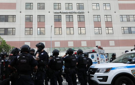 The police gathered outside Bronx-Lebanon Hospital Center in New York on Friday. (Credit: Uli Seit for The New York Times)