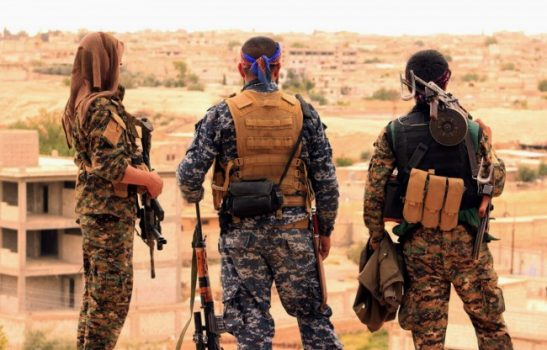 FILE - This April 30, 2017, file photo provided by the Syrian Democratic Forces (SDF) shows fighters from the SDF looking toward the northern town of Tabqa, Syria. (Syrian Democratic Forces via AP, File)
