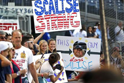 Supporters of Minority Whip Steve Scalise, R-La., hold signs before the Congressional baseball game, Thursday, June 15, 2017, in Washington. The annual GOP-Democrats baseball game raises money for charity. (AP Photo/Alex Brandon)