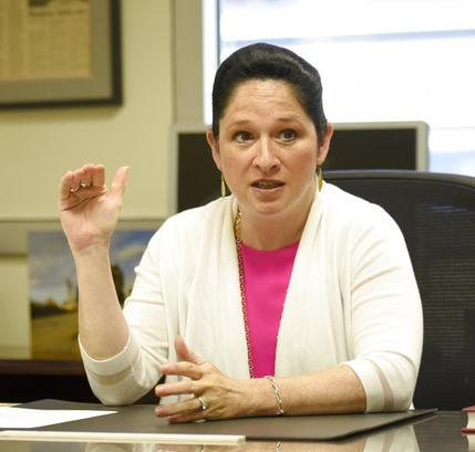 In this June 14, 2017, photo, Illinois Comptroller Susana Mendoza, Illinois, responds to a reporter's question during an interview in here office about the state budget in Chicago. As Illinois nears its third year without a state budget, Ms. Mendoza must prioritize what gets paid as new court orders mean her office must pay out more each month than Illinois receives in revenue. (AP Photo/G-Jun Yam)
