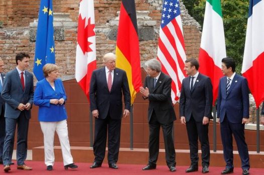 FILE PHOTO: From L-R, European Council President Donald Tusk, Canadian Prime Minister Justin Trudeau, German Chancellor Angela Merkel, U.S. President Donald Trump, Italian Prime Minister Paolo Gentiloni, French President Emmanuel Macron, Japanese Prime Minister Shinzo Abe react during a family photo during the G7 Summit in Taormina, Sicily, Italy, May 26, 2017.  REUTERS/Philippe Wojazer/File Photo